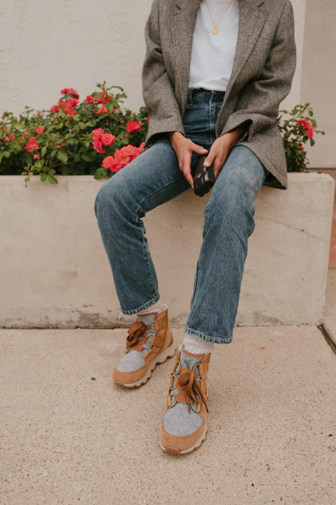 Lauren Johnson of Disco Daydream wears an oversized plaid blazer and Sorel Kinetic Boots from Urban Outfitters